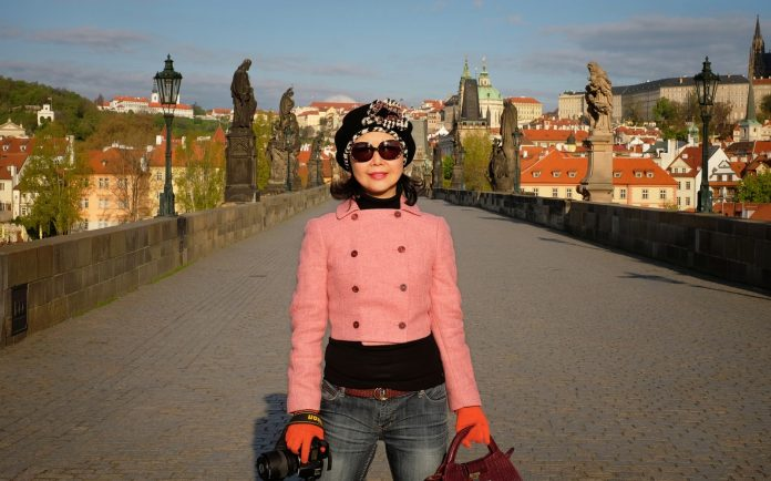 White Caviar Life fashion portrait on location at Charles Bridge in Prague.