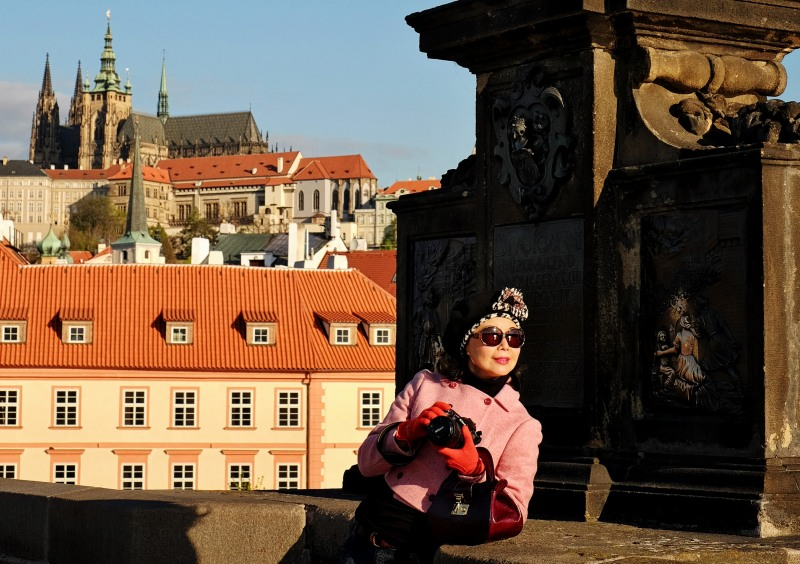 White Caviar Life fashion story on location at Charles Bridge in Prague.