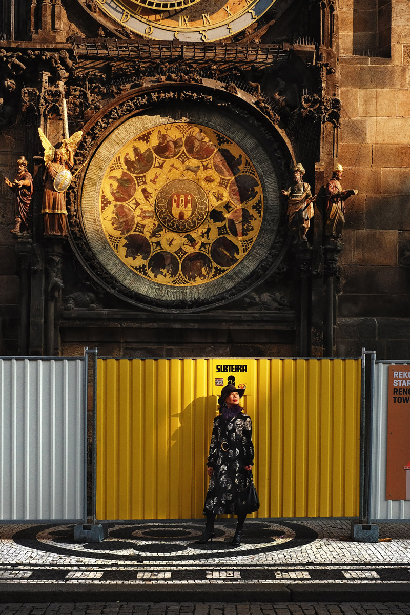 Prague astronomical clock fashion shoot by fashion photographer Kent Johnson for White Caviar Life.