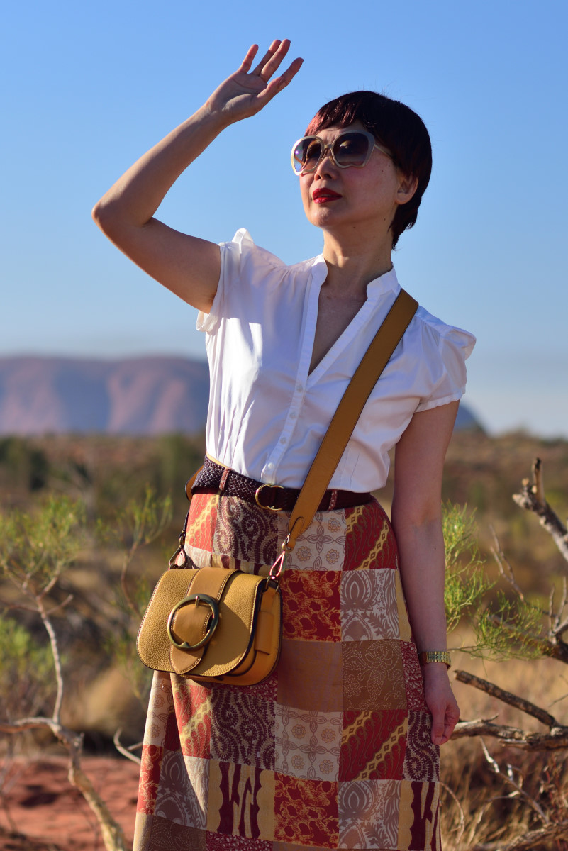 Environmental conscious fashion story by White Caviar Life. Photoshoot on location at Uluru by fashion photographer Kent Johnson.