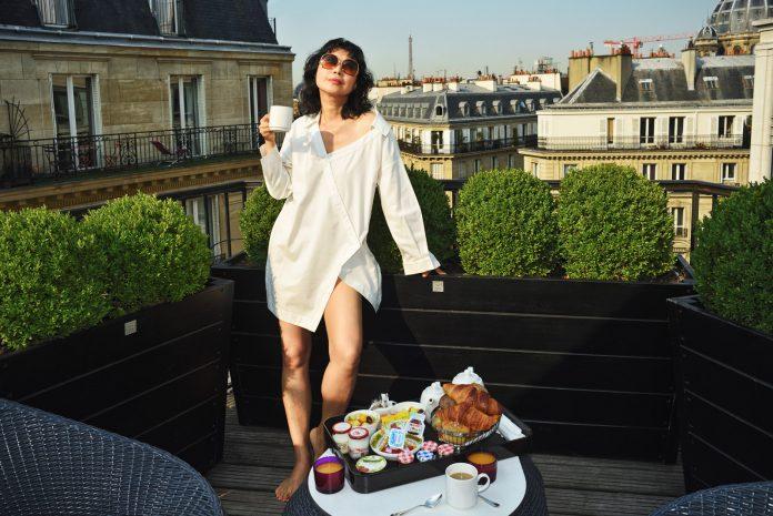 Paris rooftop terrace with the Eiffel Tower view. Fashion portrait by Australian photographer Kent Johnson for White Caviar Life.