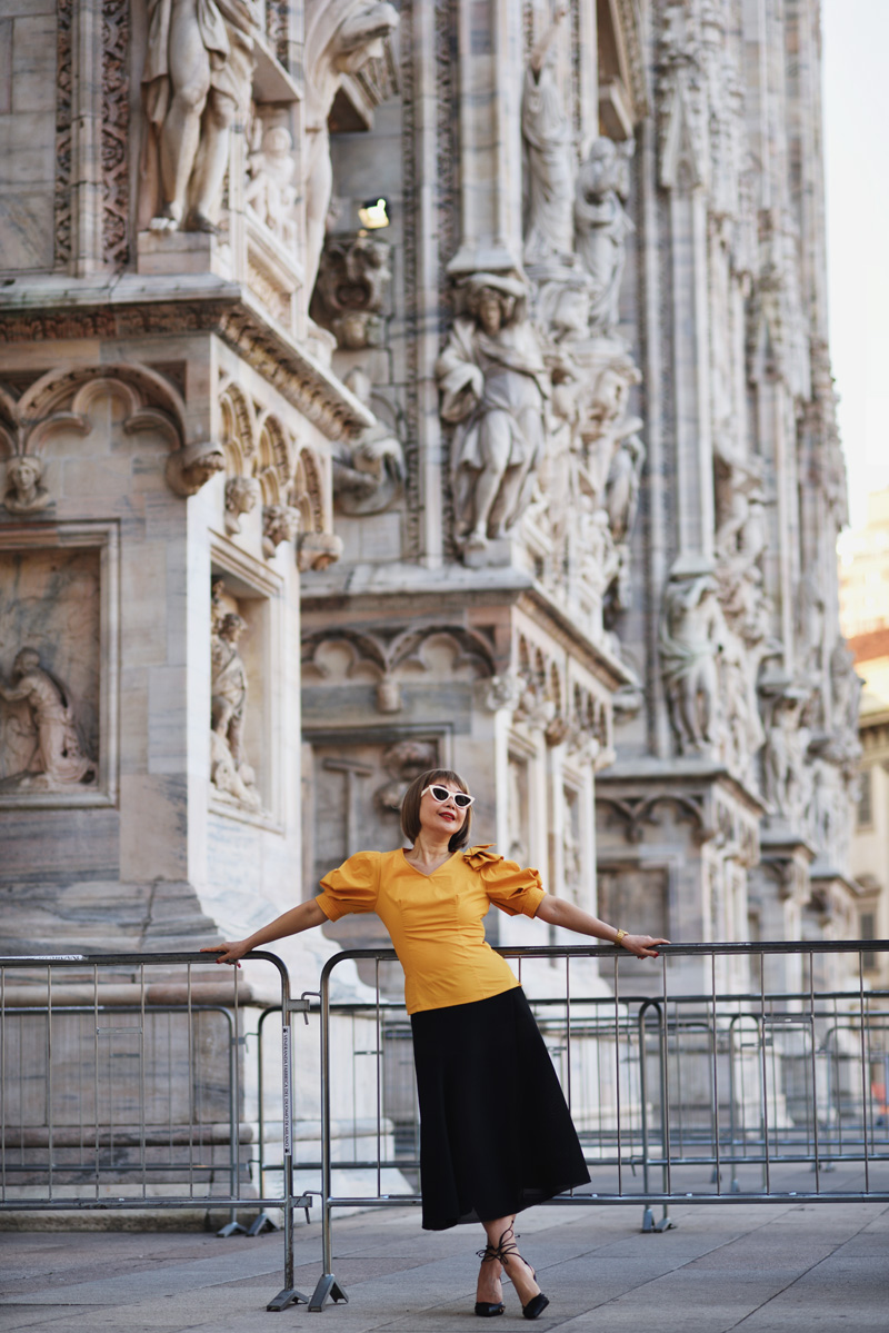 White Caviar Life Milan fashion shoot on location at Milan Cathedral (Duomo di Milano) by fashion photographer Kent Johnson.