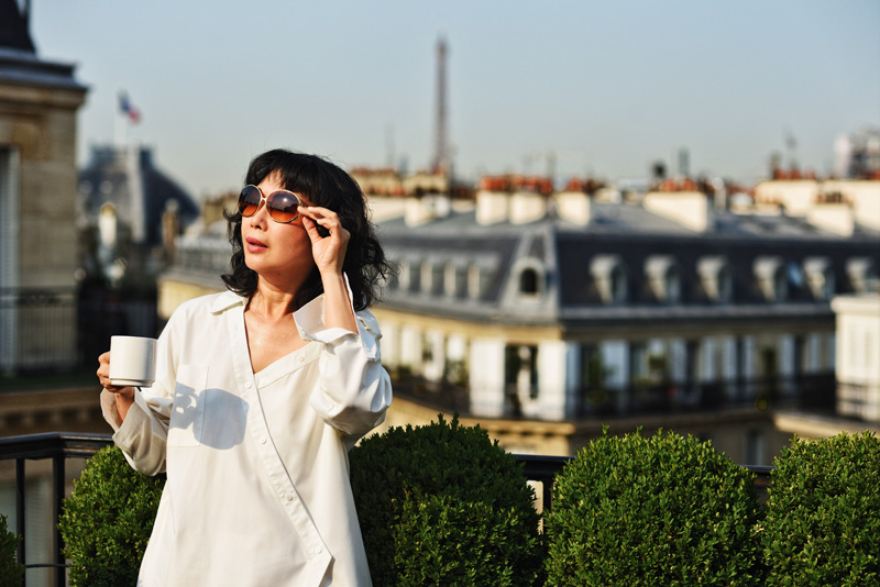 Paris rooftop terrace with the Eiffel Tower view. Fashion portrait by Australian photographer Kent Johnson for White Caviar Life.