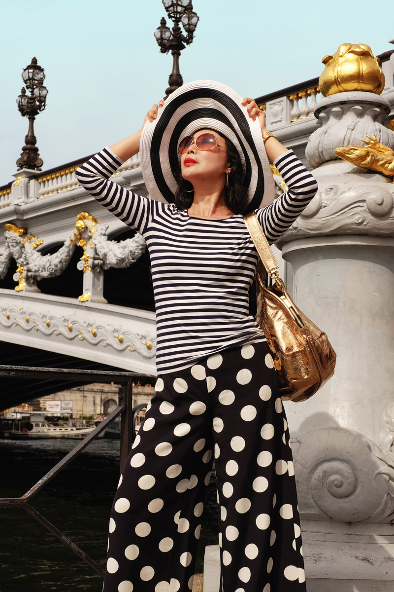 How to dress like a Parisienne style tips by White Caviar Life. Location shoot at Pont Alexandre III by fashion photographer Kent Johnson.