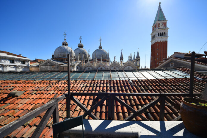 Suite with a rooftop view of St Mark's Basilica and St Mark's Campanile. Reviews of Relais Piazza San Marco by White Caviar Life.
