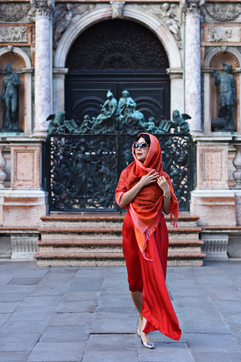 Woman in red Venice fashion shoot at the St Mark's Square by Australian fashion photographer Kent Johnson. Styling and story by Vivienne She for White Caviar Life.