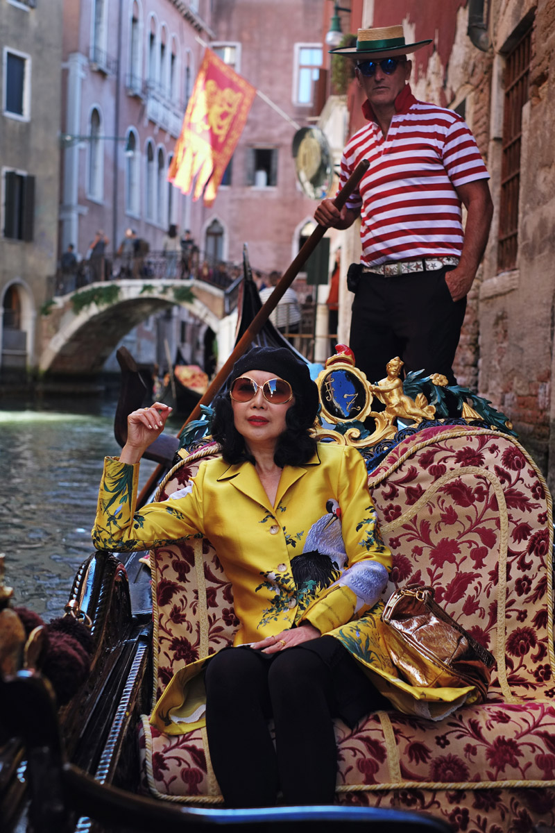 Fashion photoshoot on a Venetian gondola with a Venetian gondolier by photographer Kent Johnson. Styling and modelling by Vivienne She for White Caviar Life.